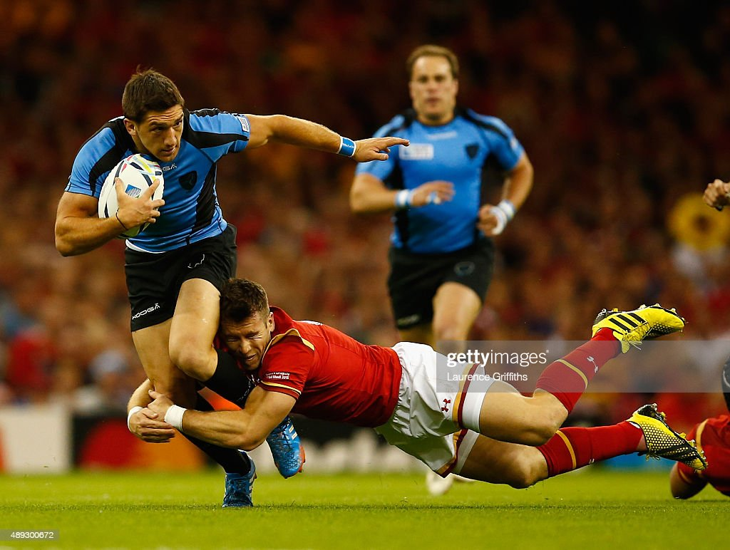 Agustin Ormaechea of Uruguay is tackled by Liam Williams of Wales during the 2015 Rugby World Cup Pool A match between Wales and Uruguay at Millennium Stadium on September 20, 2015 in Cardiff, United Kingdom.