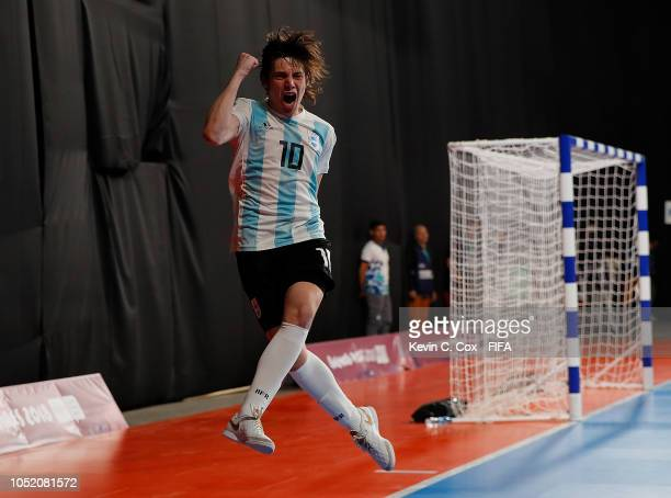 Agustin Raggiati of Argentina celebrates scoring the 10th goal against Panama in the Men's Futsal Group A match between Panama and Argentina during...
