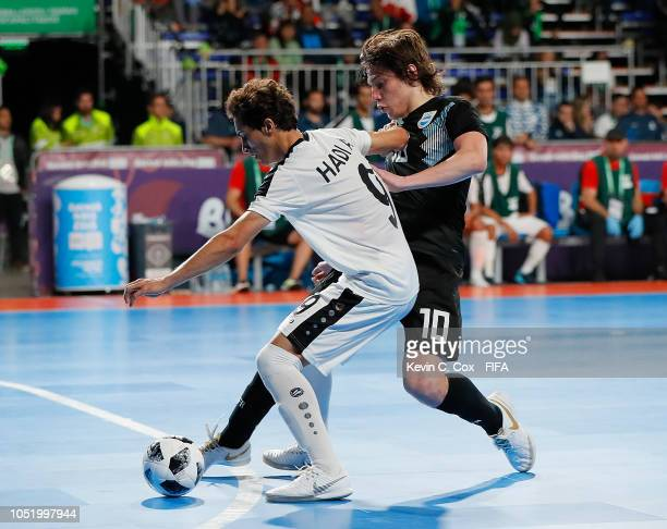 Agustin Raggiati of Argentina challenges Hadi Alaa of Iraq in the Men's Futsal Group A match between Argentina and Iraq during the Buenos Aires Youth...