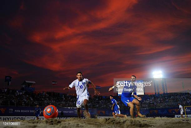 Agustin Ruiz of El Salvador is challenged by Francesco Corosinitti of Italy during the FIFA Beach Soccer World Cup Quarter Final match between Italy...