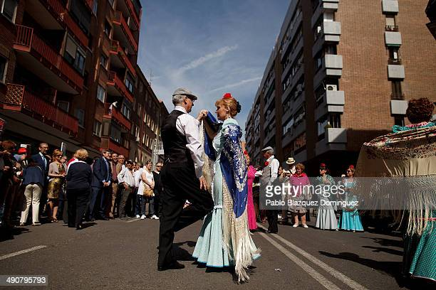 Agustin Torres and Paloma Clemente dance a 'chotis' during the San Isidro festivities near Pradera de San Isidro park on May 15 2014 in Madrid Spain...