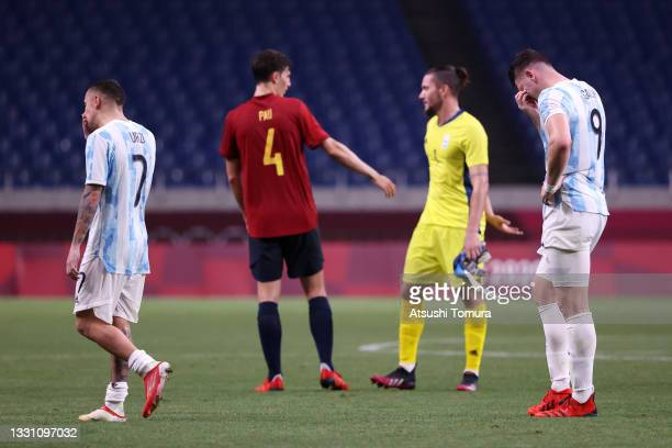 Agustin Urzi and Adolfo Gaich of Team Argentina look dejected after the Men's First Round Group C match between Spain and Argentina on day five of...
