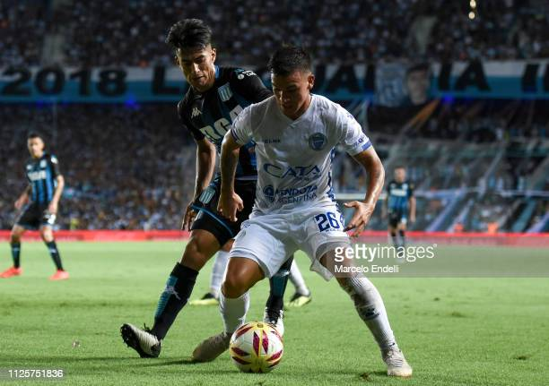 Agustin Verdugo of Godoy Cruz fights for the ball with Alexis Soto of Racing Club during a match between Racing Club and Godoy Cruz at Juan Domingo...