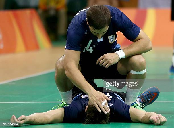 Agustin Vidal consoles teammate Federico Pizarro of Argentina after the loss to Croatia on Day 4 of the Rio 2016 Olympic Games at the Future Arena on...