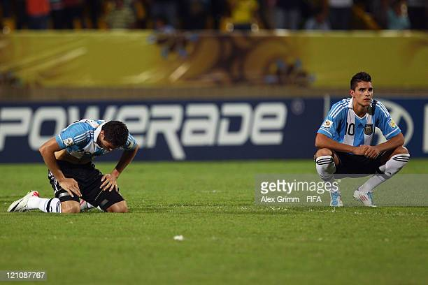 Agustin Vuletich and Erik Lamela of Argentina react after the FIFA U20 World Cup 2011 quarter final match between Portugal and Argentina at Estadia...