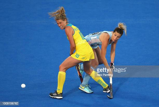 Agustina Albertarrio of Argentina shoots under pressure from Maddy Fitzpatrick of Australia during the quarter final game between Australia and...