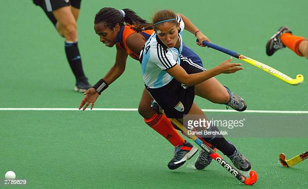 Agustina Garcia of Argentina is fouled by Maartje Scheepstra of Netherlands during the BDO Hockey Champions Trophy 3rd place playoff match between...