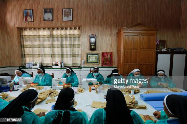 Agustinian nuns of San Leandro convent make face masks and health coats instead of their traditional convent cakes called Yemas de San Leandro on...