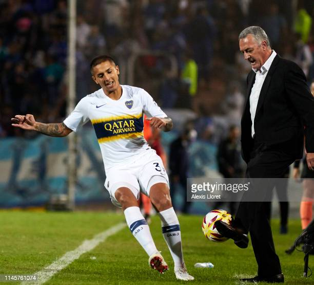 Agustín Almendra of Boca Juniors and Gustavo Alfaro head coach of Boca Juniors during a first leg round of sixteen match between of Godoy Cruz and...