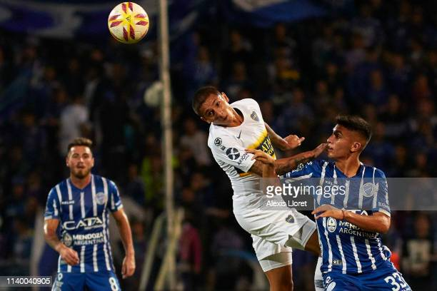 Agustín Almendra of Boca Juniors fights for the ball with Ezequiel Bullaude of Godoy Cruz during a first leg round of sixteen match between of Godoy...