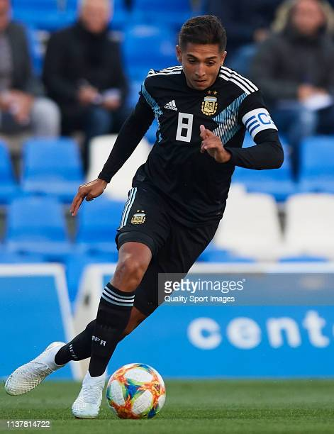 Agustín Almendra of the Argentina runs with the ball during the U20 International friendly match between Argentina and Japan at Pinatar Arena on...