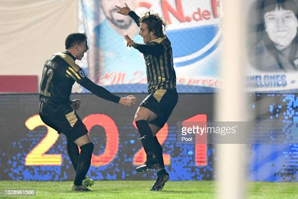 Agustín Canobbio of Peñarol celebrates with teammate Joaquín Piquerez of Peñarol after scoring the first goal of his team during a round of sixteen...