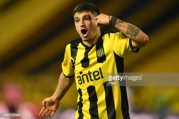 Agustín Álvarez Martínez of Peñarol reacts after being injured during a round of sixteen second leg match between Peñarol and Nacional as part of...