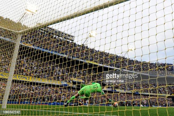 Agustín Rossi of Boca Juniors fails to stop a goal by Lucas Pratto of River Plate during the first leg match between Boca Juniors and River Plate as...