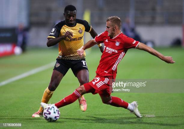 Agyemang Diawusie of Dynamo Dresden is challenged by Alexander Lungwitz of FC Bayern Muenchen II during the 3 Liga match between Bayern Muenchen II...