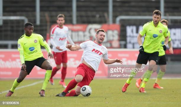 Agyemang Diawusie of Wiesbaden tackles Maik Kegel of Cologne during the 3 Liga match between SC Fortuna Koeln and SV Wehen Wiesbaden at Suedstadion...