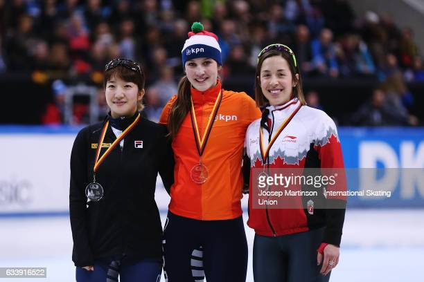 Ah Rum Noh of Korea Suzanne Schulting of Netherlands and Valerie Maltais of Canada pose in the Ladies 1500m medal ceremony during day two of the ISU...