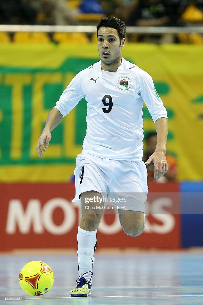 Ahamed Fathe #9 of Libya attacks against Brazil during the FIFA Futsal World Cup, Group C match between Brazil and Libya at Korat Chatchai Hall on November 4, 2012 in Nakhon Ratchasima, Thailand.