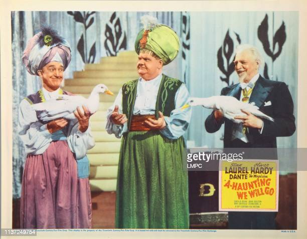 Ahaunting We Will Go US lobbycard from left Stan Laurel Oliver Hardy Danete 1942