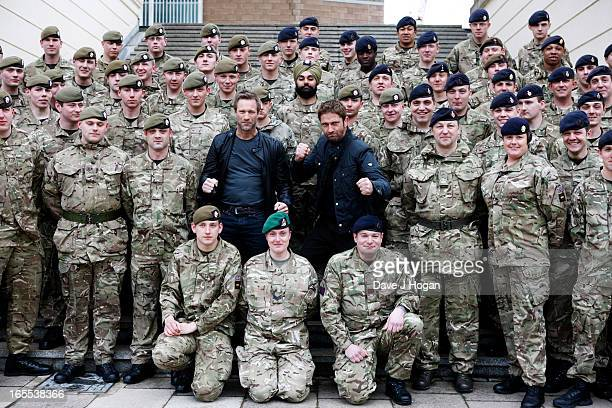 Ahead of a special preview screening Gerard Butler and Aaron Eckhart attend a photocall for 'Olympus Has Fallen' at The Wellington Barracks on April...
