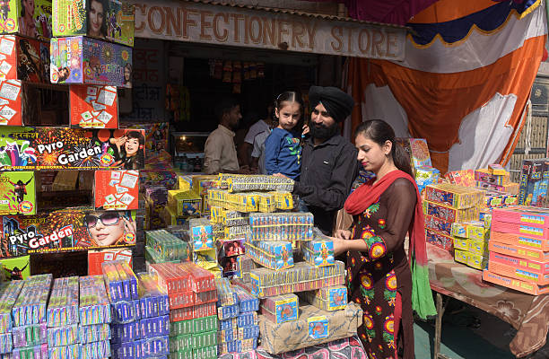 Ahead of Diwali customers buying crackers on sale at cracker market at Kurali on October 26 2016 in Chandigarh India Diwali is the major festivals of.