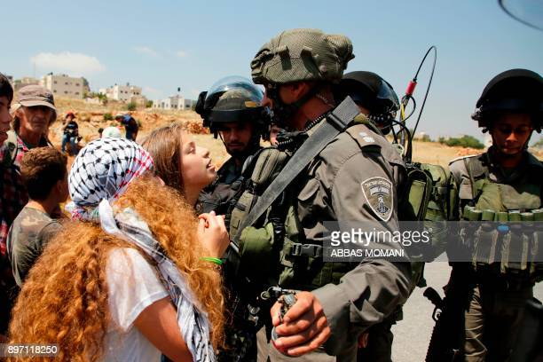 Ahed Tamimi a 16yearold Palestinian protests before Israeli forces in the West Bank village of Nabi Saleh north of Ramallah on May 12 after a...