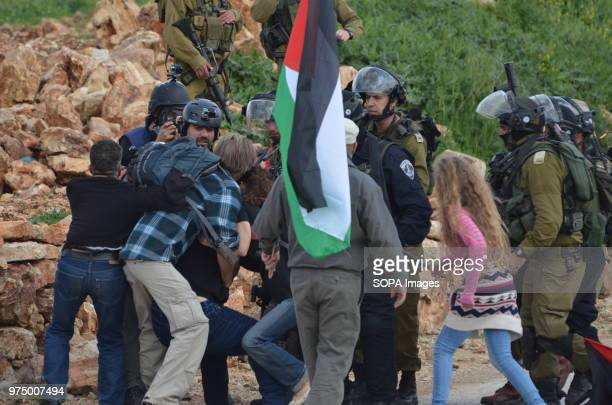Ahed Tamimi attempts to stop Israeli soldiers arresting protesters during the Friday protests Nabi Saleh is a village in Palestine which regularly...