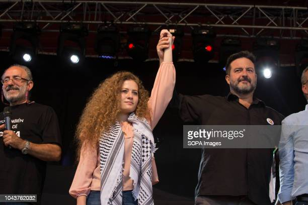Ahed Tamimi seen raising up her hand during the tour Ahed Tamimi on her European tour during the Spanish Communist festivities Party She is an...
