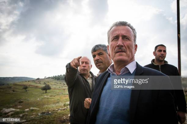 Ahed Tamimi's father goes on with his life He is seen here with a government administrator looking at the land around the small town of Nabi Salih...