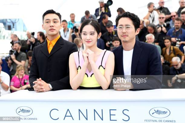 Ahin Yoo actress Jongseo Jeon and Steven Yeun attends 'Burning' Photocall during the 71st annual Cannes Film Festival at Palais des Festivals on May...