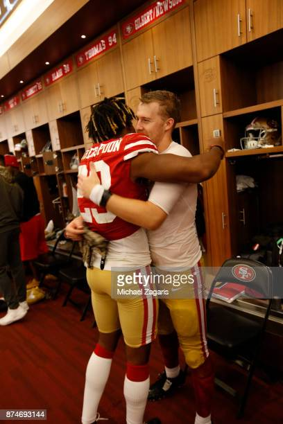 Ahkello Witherspoon and CJ Beathard of the San Francisco 49ers celebrate in the locker room following the game against the New York Giants at Levi's...