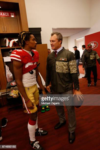 Ahkello Witherspoon and General Manager John Lynch of the San Francisco 49ers talk in the locker room following the game against the New York Giants...