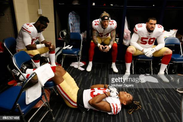 Ahkello Witherspoon Elijah Lee Cassius Marsh and Aaron Lynch of the San Francisco 49ers relax in the locker room prior to the game against the...