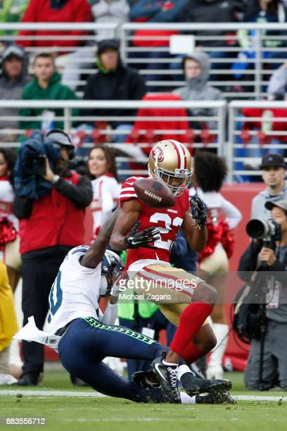 Ahkello Witherspoon of the San Francisco 49ers breaks up a pass during the game against the Seattle Seahawks at Levi's Stadium on November 26 2017 in...