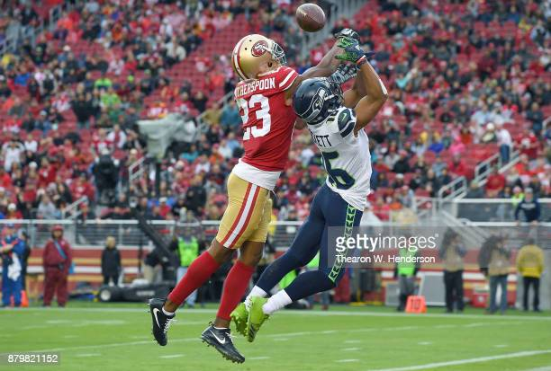 Ahkello Witherspoon of the San Francisco 49ers breaks up the pass to Tyler Lockett of the Seattle Seahawks during their NFL football game at Levi's...