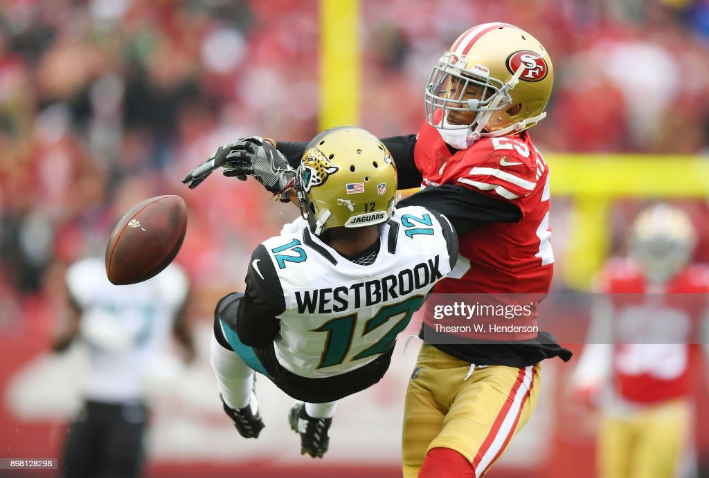 Ahkello Witherspoon #23 of the San Francisco 49ers breaks up the pass to Dede Westbrook #12 of the Jacksonville Jaguars during their NFL football game at Levi's Stadium on December 24, 2017 in Santa Clara, California.
