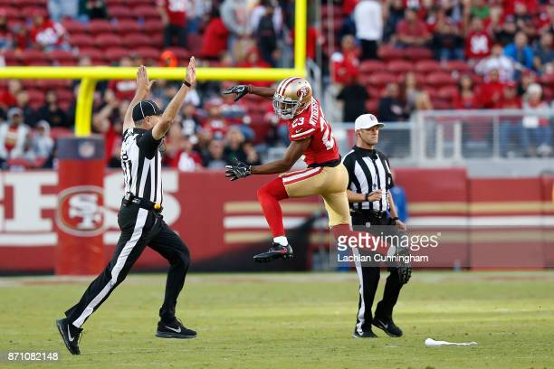 Ahkello Witherspoon of the San Francisco 49ers celebrates a turnover against the Arizona Cardinals at Levi's Stadium on November 5 2017 in Santa...