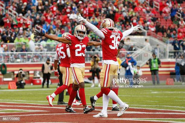 Ahkello Witherspoon of the San Francisco 49ers celebrates with teammate Dontae Johnson after breaking up a pass against the Seattle Seahawks at...