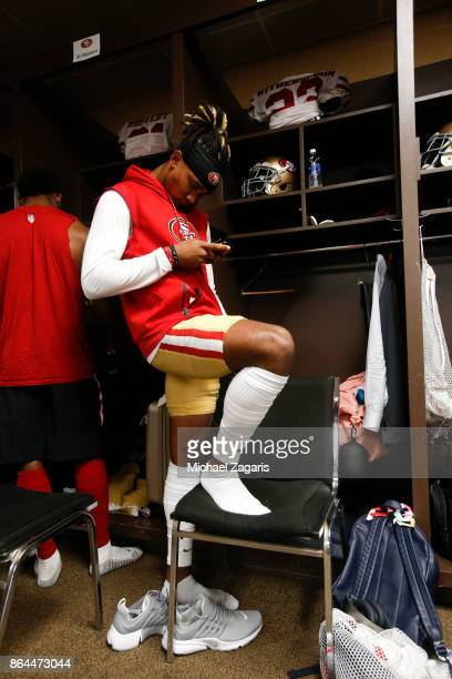 Ahkello Witherspoon of the San Francisco 49ers checks his phone in the locker room prior to the game against the Washington Redskins at FedEx Field...