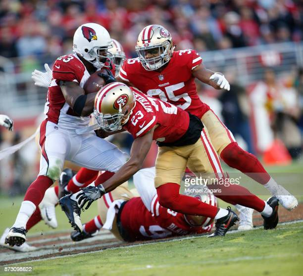 Ahkello Witherspoon of the San Francisco 49ers tackles Adrian Peterson of the Arizona Cardinals during the game at Levi's Stadium on November 5 2017...