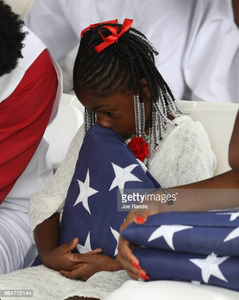 Ah'Leesya Johnson holds a folded American flag given to her during the burial service for her father US Army Sgt La David Johnson at the Memorial...