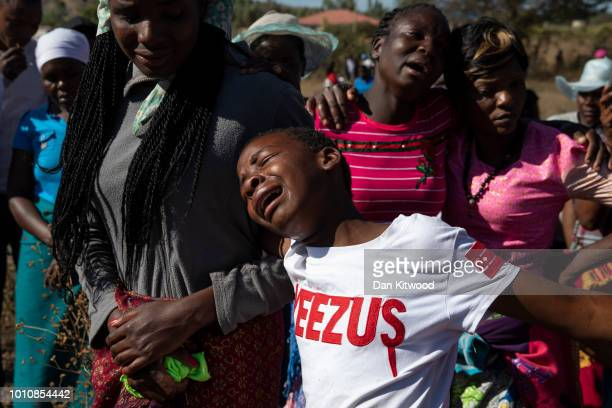 Ahlia mourns the death of her father as the funeral takes place for father of four Ishmael Kumire on August 4 2018 in Chinamhora Zimbabwe Ishmael was...