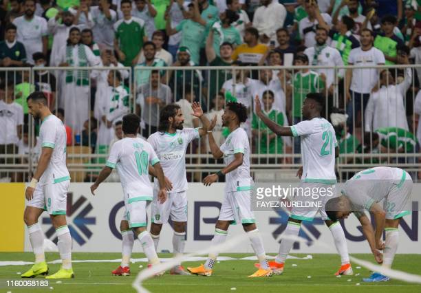 Ahli's players celerbate their goal during their AFC Champions League play-off football match between Saudi's al-Ahli and al-Hilal at King Abdullah...