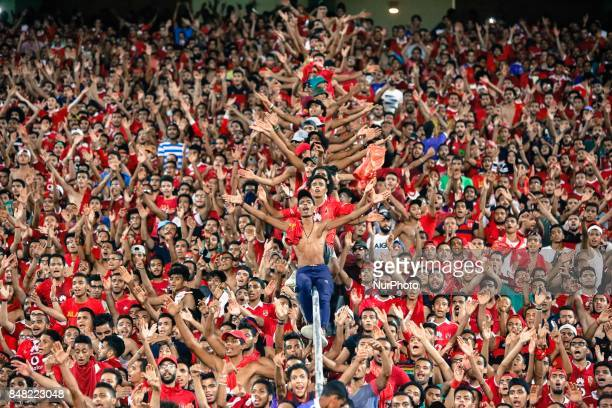 Ahly fans cheer before the CAF Champions League quarterfinal firstleg football match between Egypt's AlAhly and Tunisia's Esperance of Tunis at Borg...
