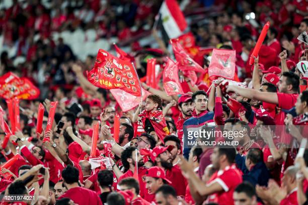 Ahly football fans cheer for their team ahead of the Egyptian Super Cup final football match between Ahly SC and Zamalek SC at Mohammed Bin Zayed...