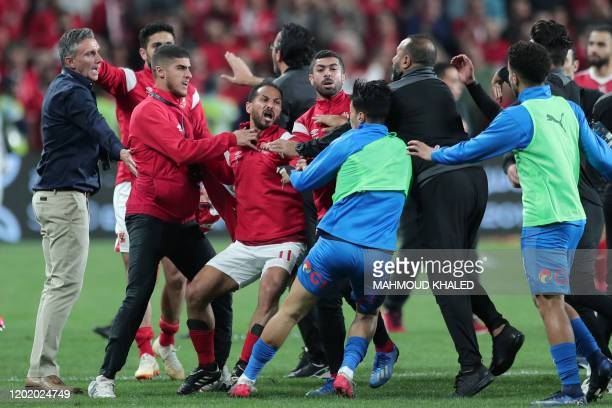 Ahly SC's players scuffle with Zamalek SC's players after the Egyptian Super Cup final football match between Ahly SC and Zamalek SC at Mohammed Bin...