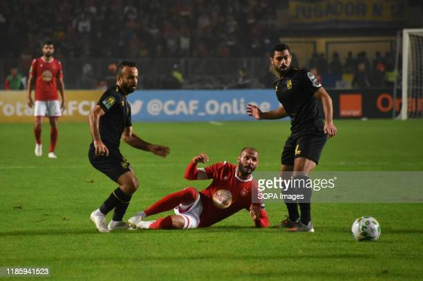 Ahly's Ahmed Fathi and Etoile's Yassin Chikhaoui in action during the CAF Champions League 2019 20 football match between AlAhly and Etoile sportive...