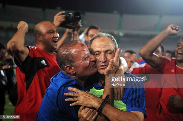 Ahly's Coach Fathy Mabrouk celebrates after his team won the Egyptian League title after the Egyptian Premier League soccer match at the Cairo...