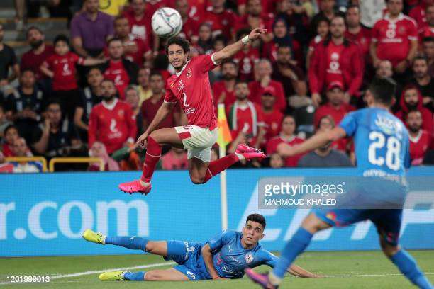 Ahly's defender Mohamed Hani leaps to head the ball while vying against Zamalek's forward Achraf Bencharki during the Egyptian Super Cup final...