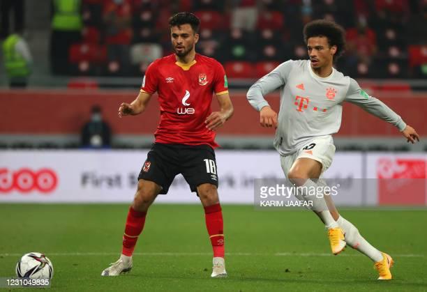 Ahly's forward Salah Mohsen is closed down by Bayern Munich's German midfielder Leroy Sane during the FIFA Club World Cup semi-final football match...